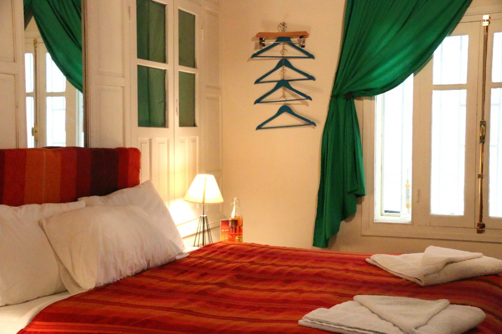 Queen bed with external window